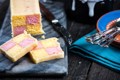 Serving Battenberg checked cake Royalty Free Stock Photography