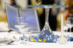 Serving beautiful dishes on the table. Stock Photography