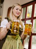 Serving beer at Oktoberfest Royalty Free Stock Photo