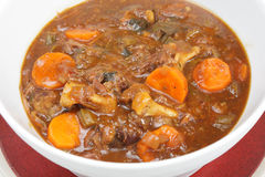 Serving bowl of oxtail stew. A serving bowl full of freshly home-made oxtail stew, a delicious traditional British or European food Royalty Free Stock Image