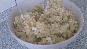 Serving bowl of potato salad stock video