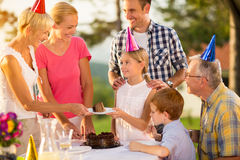 Serving cake at birthday party Stock Image