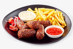 Serving of cevapcici with French fries Royalty Free Stock Photography
