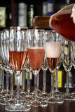 Serving champagne. Filling some glasses with champagne Stock Photography
