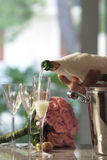 Serving champagne. In a flute glass Stock Photos