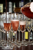 Serving champagne. Filling some glasses with champagne Royalty Free Stock Photos