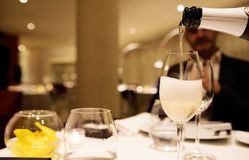 Serving Champagne in the restaraunt Stock Photos