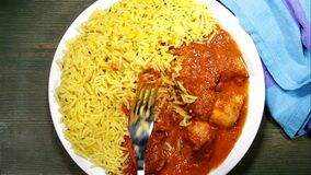 Serving Chicken Madras Curry With Pilau Rice stock footage