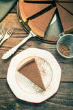 Serving chocolate tort , vintage tonned effect Royalty Free Stock Photography