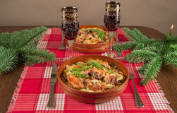 Serving Christmas table. Spruce branches, two glasses of wine, homemade feast Stock Images