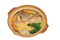 Serving On Claypot Fish Head Noodle Royalty Free Stock Photography