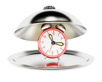 Serving cloche with alarm clock Royalty Free Stock Photo