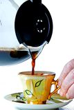 Serving coffee. In a cup of coffee Royalty Free Stock Photos