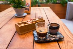 Serving coffee in a cafe. On a wooden table royalty free stock image