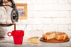Serving coffee on a red cup with handmade sponge cake royalty free stock photos