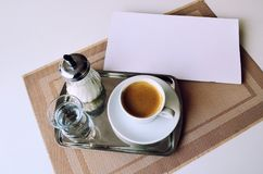 Serving coffee in the restaurant. Coffee, a glass of water and sugar on an iron tray. Serving coffee in the restaurant. Coffee, glass of water and sugar on an royalty free stock photo