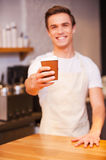 Serving coffee to Go. Royalty Free Stock Photography