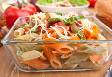 Serving of colored penne pasta Stock Images