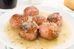 Serving of cooked meatballs in sauce, on dish Stock Photography