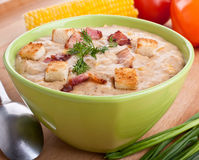 Serving of corn cream soup puree Stock Photography