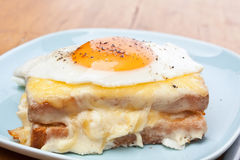 Serving of Croque Madame. Ham, Cheese and Fried Egg Sandwich stock photos