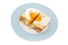 Serving of Croque Madame. (Ham, Cheese and Fried Egg traditional French Sandwich) cut in half Stock Photo