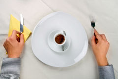 Serving a cup of coffee. Man waiting near a plate with a cup of coffee on it Stock Images