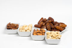 A serving of dates and assorted nuts Royalty Free Stock Photography