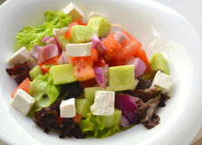 Serving of delicious fresh Greek salad Stock Photos