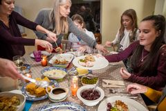 Serving Dinner at Thanksgiving Royalty Free Stock Photos