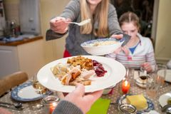 Serving Dinner at Thanksgiving Stock Photography