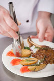 Serving the dish. Royalty Free Stock Photo