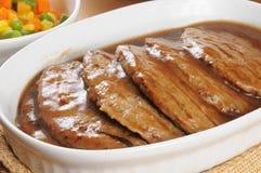 Serving dish of salisbury steak Stock Images