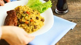 Serving dish from turkey meat with rice and salad leaves and a glass of juice with ice stock footage