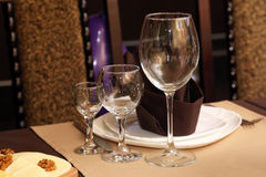 Serving dishes on the table in the restaurant Royalty Free Stock Photo