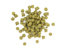 A serving of dried granulated green hops. On a white background Royalty Free Stock Image