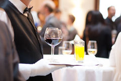 Serving drinks at a party Royalty Free Stock Photo