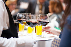 Serving drinks at a party Royalty Free Stock Photos