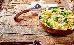 Serving of farfalle pasta with broccoli and cheese stock images