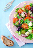 Serving of feta cheese salad with olives Stock Photo