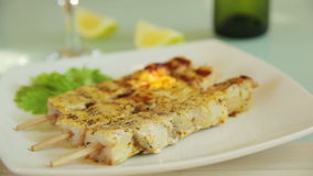 Serving fish kebab with white wine and lemon. Skewers of fish fried on a grill. preparation for frying fish kebab. Pepper sauce stock video