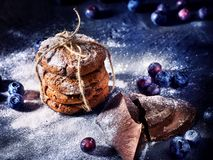 Chocolate chip cookies tied with string. Serving food on slate royalty free stock images