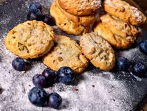 Chocolate chip cookies tied with string. Serving food on slate royalty free stock photo