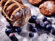 Chocolate chip cookies tied with string. Serving food on slate stock images