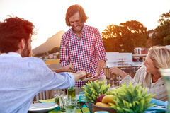 Serving food to friends Stock Image