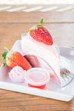Serving fresh strawberry crepe cake Stock Image