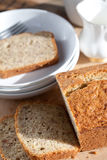 Serving freshly baked banana bread on wooden board Royalty Free Stock Photography