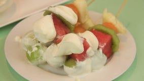 Serving Fruit Kebabs 4 stock video footage