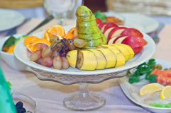 Serving fruits at a festive new year and Christmas table. Dessert Stock Photo