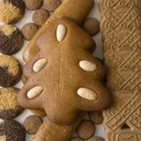 Gingerbread Christmas tree and an assortment of Christmas cookies royalty free stock images